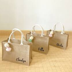 Just the right size with enough space to throw anything inside. Get this Mini Jute Bag with free custom lettering and pompom. Now available additional long strap by request.